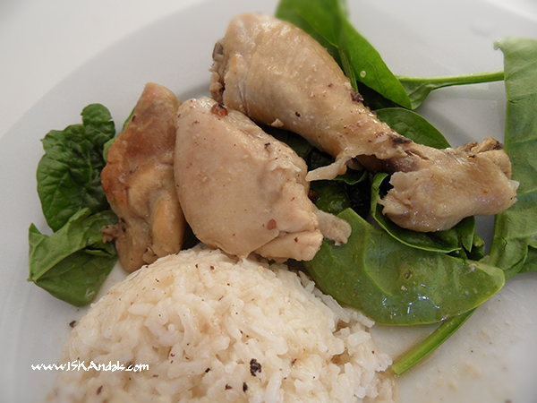 Chicken white adobo with steamed rice and fresh baby spinach leaves